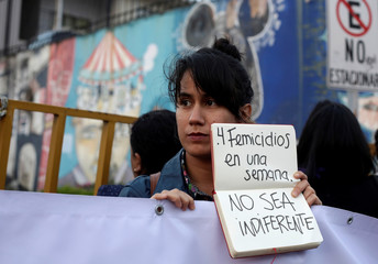 A women takes part in a protest and vigil against femicide in San Jose, Costa Rica
