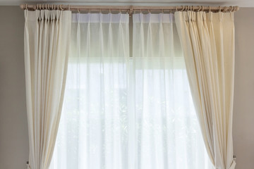 White curtain inside the window. Home interior decoration