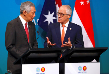 Australian Prime Minister Malcolm Turnbull walks behind Prime Minister of Singapore Lee Hsien Loong talk during their media conference during the one-off ASEAN summit in Sydney