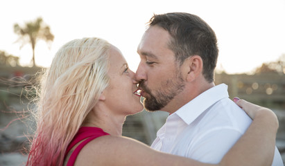 couple look into each others eyes before kissing