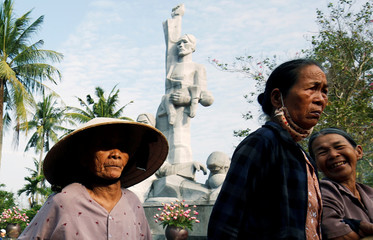 Vietnamese villagers attend the 50th anniversary of the My Lai massacre in My Lai village