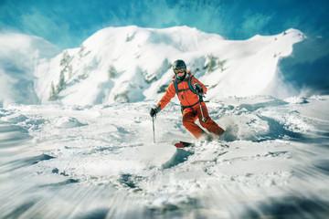 Female skiers dynamic ride in deep snow