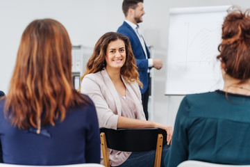 Happy woman attending a seminar or presentation