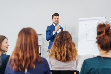 Smart businessman giving a lecture or presentation
