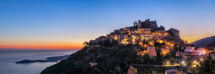 Panoramic view of medieval hilltop village Eze at dusk,  Alpes-Maritimes, France Fototapete