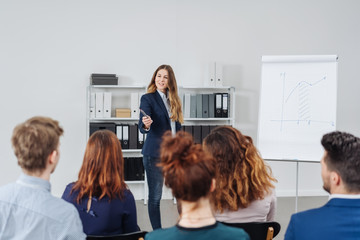 Businesswoman lecturing to a group of colleagues