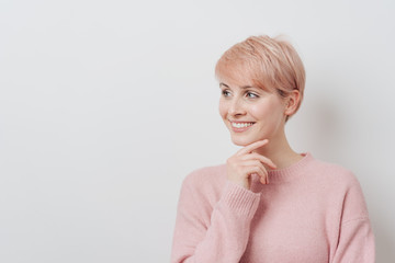Smiling friendly young blond woman