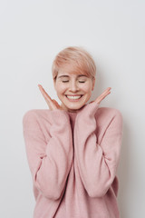 Ecstatic young blond woman with a beaming smile