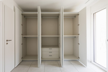 Empty room with large wardrobe