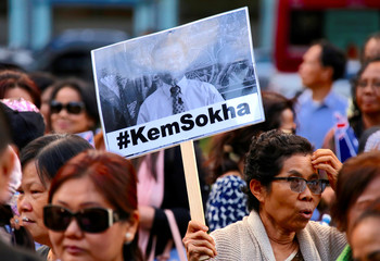 A protester holds a placard during a demonstration against Cambodia's PM Hun Sen, who is attending the ASEAN summit in Sydney