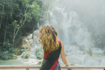 Woman looking at waterfall