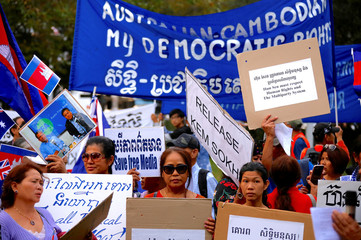 Protesters hold placards and banners during a demonstration against Cambodia's PM Hun Sen, who is attending the ASEAN summit in Sydney