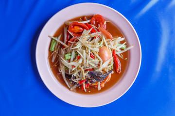 Papaya salad on table,National food of Thailand,Papaya salad and grilled Chicken