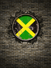 Old  Jamaica flag in brick wall