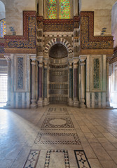 Mausoleum of Sultan Qalawun with decorated colorful marble niche (Mihrab) embedded in ornate marble wall, and colorful stain glass windows, Moez Street, Cairo, Egypt