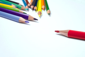 Business concepts: red crayon standing out from the crowd
