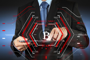 Businessman working with new modern computer and Bitcoin cryptocurry virtual diagram as concept.