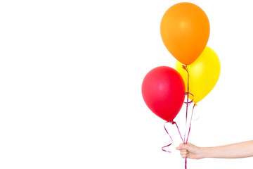 Womans hand holds balloons in a white background isolated