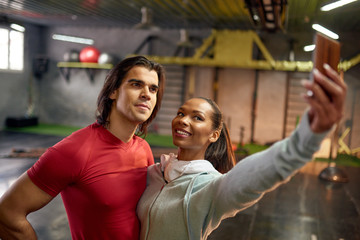 Couple making selfie in the gym