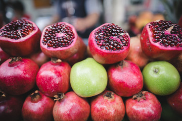 pomegranates and apples on market stall in Istanbul, Turkey
