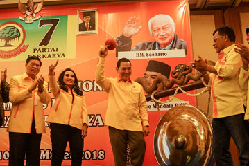 "The youngest son of former Indonesian president Suharto, Hutomo ""Tommy"" Mandala Putra, hits the gong at the opening of the Berkarya (Working) Party national meeting in Solo, Central Java"
