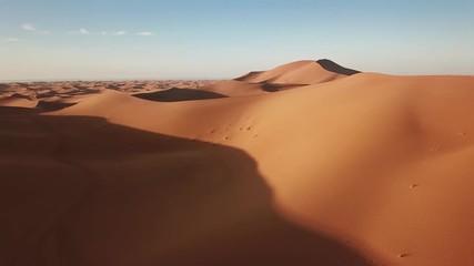 Fototapete - Aerial view on sand dunes in Sahara desert at sunrise, Africa, 4k