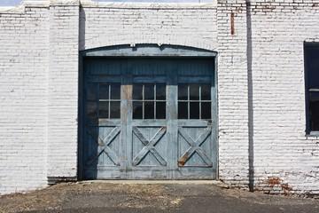 weathered wooden sliding garage door