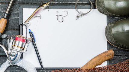 Fishing gear - fishing, fishing, hooks and baits, an old sheet of paper on a wooden background.