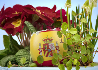 The flag of Spain on an cracked egg in a floral scene.(series)