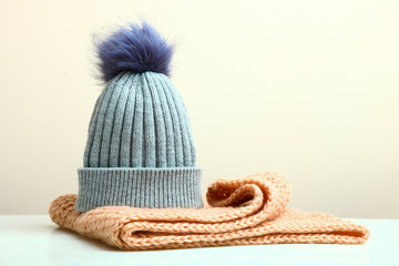 hat and a knitted scarf