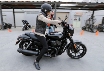 Maryam Ahmed Al-Moalem, a Saudi female bike rider, rides a biker during her lessons in advanced motorbike training at Harley Davidson training centre in Manama