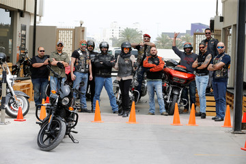 Maryam Ahmed Al-Moalem, a Saudi female bike rider (C), poses for a group photo with Bahrain and Saudi riders during her lessons in advanced motorbike training at Harley Davidson training centre in Manama