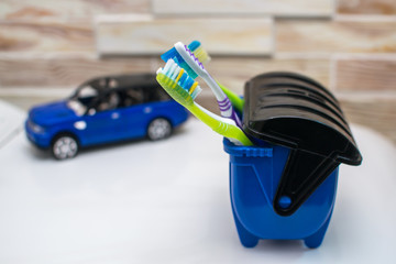 Toothbrushes in a blue trash can, lots of germs so threw away