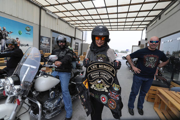 Maryam Ahmed Al-Moalem, a Saudi female bike rider, poses with Jeddah Chapter Saudi Arabia biker vest, during her lessons in advanced motorbike training at Harley Davidson training centre in Manama