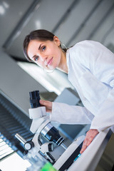 Portrait of a female chemistry student/scientist carrying out research in a chemistry lab (color toned image; shallow DOF)