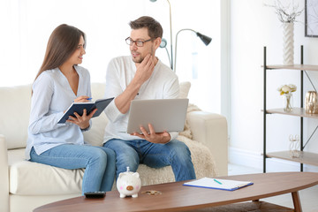 Young couple thinking over pension plan at home
