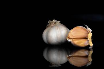 Garlic on a black background.