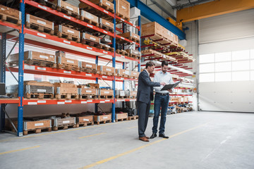 Two men walking and talking in factory shop floor