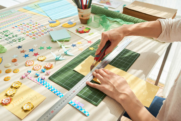 Creative Woman Concentrated on Scrapbooking