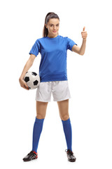 Female soccer player making a thumb up sign