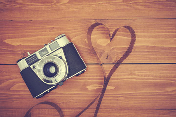 Old photo camera with film from love