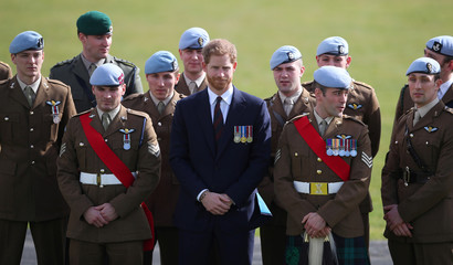 Britain's Prince Harry poses for a photograph with some of the latest graduates to have received their Wings at the Army Aviation Centre in Middle Wallop