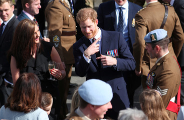 Britain's Prince Harry talks to some of the latest graduates who have received their Wings at the Army Aviation Centre in Middle Wallop