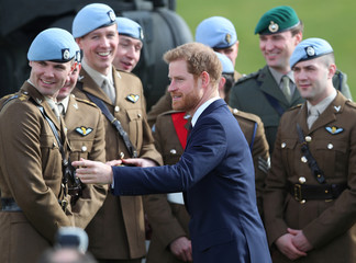 Britain's Prince Harry talks with some of the latest graduates who have received their Wings at the Army Aviation Centre in Middle Wallop