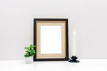 A dark wooden frame mockup 8x10