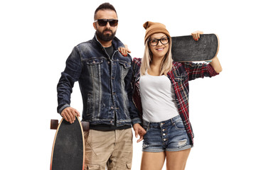 Male skater with a longboard and a female skater with a skateboard