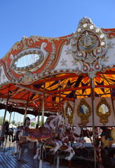 Ornate horse carousel ride for at carnival or state fair.