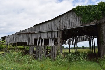 Old abandoned wooden barn, rural countryside.