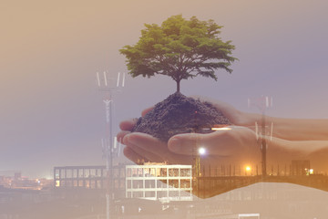 Double exposure of Man holding green plant in hand with Construction site, We love the world of ideas