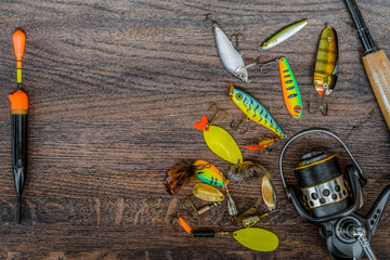 Fishing tackle still life on a wooden background.